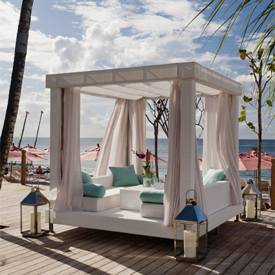 Outdoor white daybed with canopy