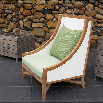 Outdoor white lounge chair with green pillow