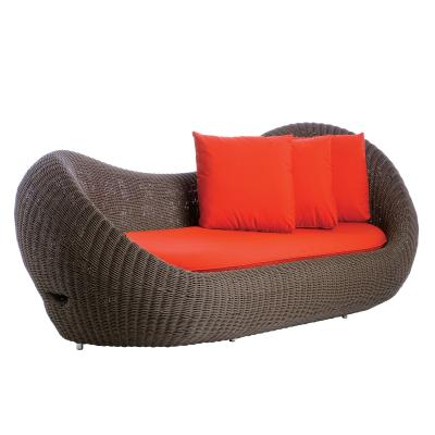 Outdoor sofa with red cushions