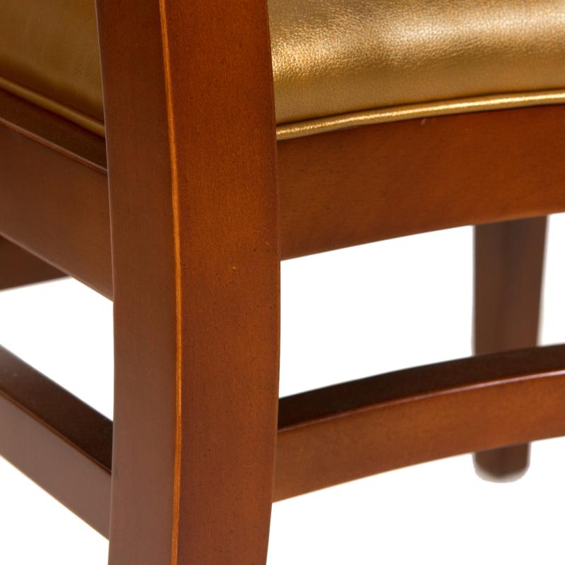 gold upholstered wood frame contemporary side chair detail