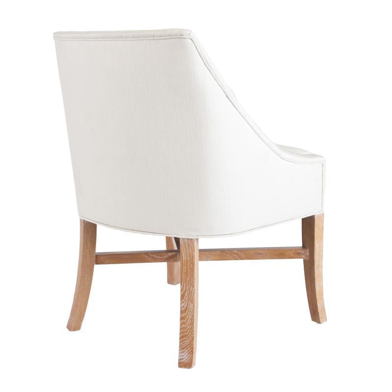White upholstered wood frame dining chair with cerused oak legs back view