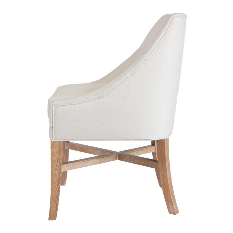 White upholstered wood frame dining chair with cerused oak legs side view