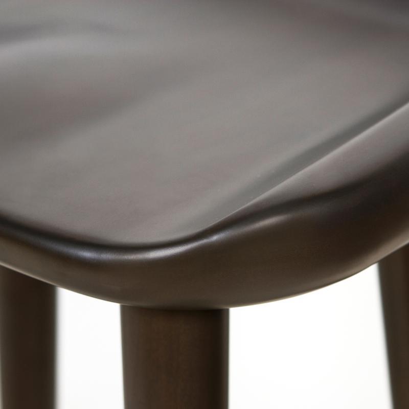 dark mahogany backless bar stool detail